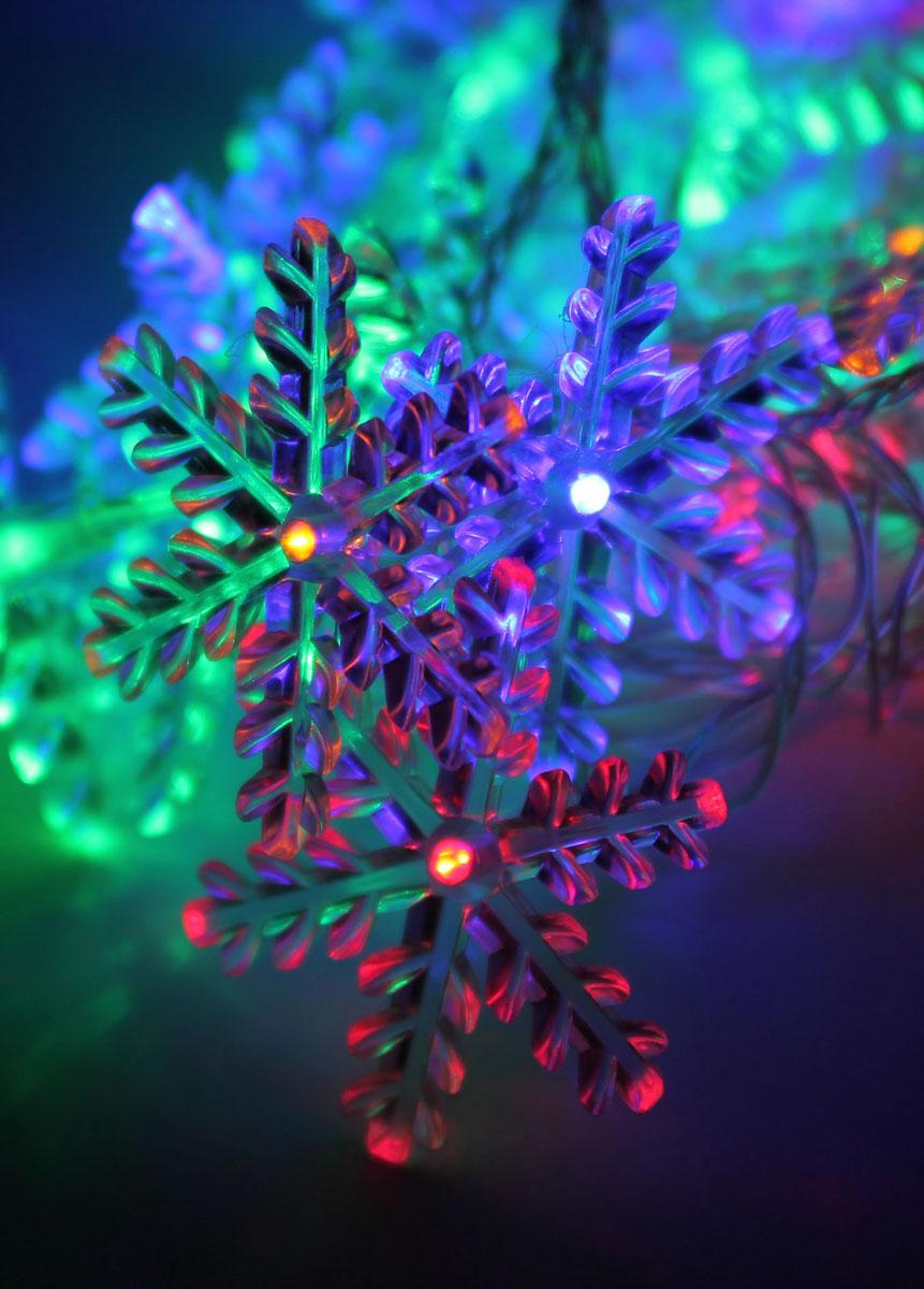 Светодиодная гирлянда Космос, 30 светодиодов, цвет: мультиколорKOC_GIR30LEDSNOW_RGBСветодиодная гирлянда Космос Снежинка с пластиковыми насадками в виде снежинок отлично подойдет для украшения новогодней елки, окна или стены. На гирлянде расположено 30 лампочек. Провод гирлянды прозрачного цвета оснащен прямоугольным контролером с кнопкой для переключения восьми режимов. Режимы мигания электрогирлянды: combination (комбинированный); in wales (волна); sequentian (последовательный); slo-glo;chasing/flash (чеканка/вспышка) ; slow fade (медленное затухание);twinkle/flash (мерцание/вспышка); steady on (постоянный). Светодиодная гирлянда Космос Снежинка создаст праздничную атмосферу и наполнит ваш дом радостью и позитивной энергией. Характеристики:Материал: пластик. Цвет свечения: мультиколор. Электропитание (от сети): 230 В. Количество светодиодов: 30 шт. Длина гирлянды: 4,4 м. Размер снежинки: 6,5 см х 6,5 см. Режимы мигания: 8. Артикул: KOC_GIR30LEDSNOW_RGB. Цвет провода: бесцветный. Расстояние между лампочками: 10 см. Цвет снежинок в выключенном состоянии: прозрачный. Длина свободного провода: 170 см.