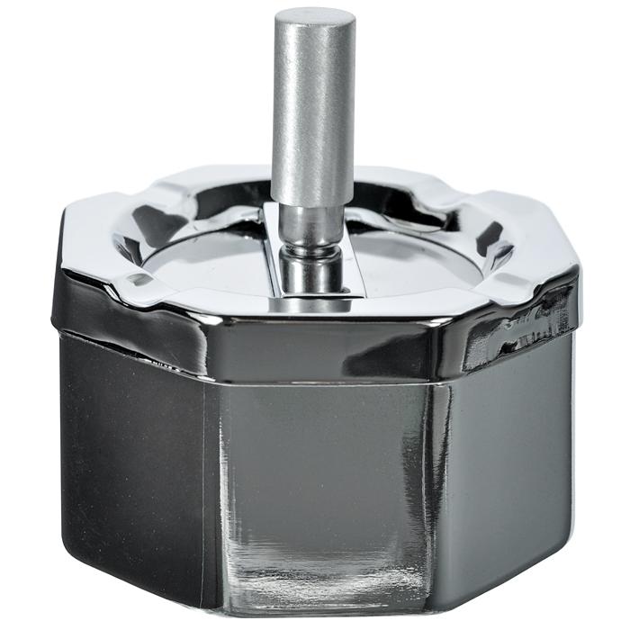 Пепельница S.Quire. 420042-928A420042-928AМеталлическая восьмиугольная пепельница S.Quire станет хорошим подарком курящим людям. Глубокий контейнер для пепла снабжен съемной крышкой, благодаря чему его можно легко чистить. На крышке пепельницы есть четыре специальных углубления для сигарет. Также крышка содержит специальный механизм очистки, благодаря которому пепел без труда попадает в контейнер. Пепельница декорирована блестящим никелевым покрытием.S.Quire - это коллекция модных, элегантных, стильных аксессуаров для мужчин, разработанная европейскими дизайнерами и отражающая все тенденции современной моды. В коллекцию S.Quire входит широкий ассортимент разнообразных товаров: фляги, заколки для галстуков, запонки, брелоки, бритвенные наборы, кружки, термосы, портсигары, пепельницы, изделия из кожи, винные аксессуары и наборы с различной комплектацией вышеперечисленных аксессуаров. Характеристики: Материал: металл, никелевое покрытие. Размер пепельницы (без ручки): 8,5 см х 8,5 см х 5 см. Высота ручки: 4 см. Размер упаковки: 9 см х 8,5 см х 6,5 см. Производитель: Италия. Изготовитель: Китай. Артикул: 420042-928A.