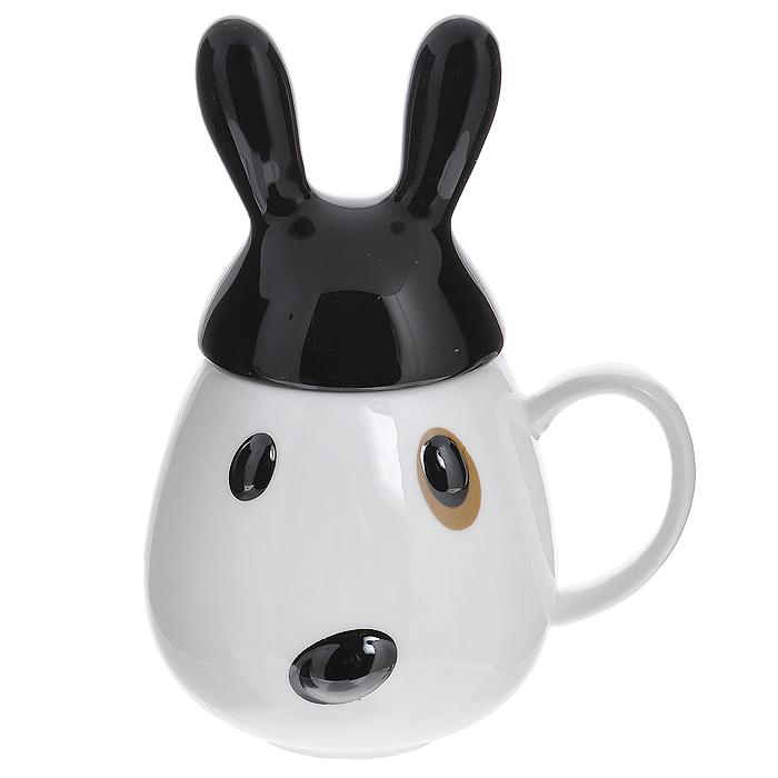 Кружка Кролик с черной крышкой002946Кружка с крышкой Кролик изготовлена из высококачественной керамики и декорирована рельефным изображением в виде забавного черно-белого кролика.Такая кружка станет незаменимым атрибутом чаепития, а оригинальный дизайн вызовет улыбку. Такая кружка станет не только приятным подарком, но и практичным сувениром. Характеристики:Материал: керамика. Диаметр кружки по верхнему краю: 6 см. Высота кружки без крышки:9,5 см. Размер упаковки: 13 см х 10,5 см х 12 см. Производитель: Китай. Артикул: 002946.