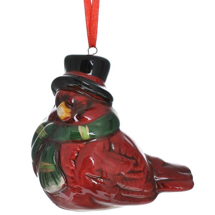 Новогоднее подвесное украшение Птичка. 3085930859Изящное новогоднее украшение Птичка выполнено из керамики. С помощью специальной текстильной петельки украшение можно повесить в любом понравившемся вам месте. Но, конечно, удачнее всего такая игрушка будет смотреться на праздничной елке.Новогодние украшения приносят в дом волшебство и ощущение праздника. Создайте в своем доме атмосферу веселья и радости, украшая всей семьей новогоднюю елку нарядными игрушками, которые будут из года в год накапливать теплоту воспоминаний. Характеристики:Материал: керамика. Цвет: темно-красный. Размер украшения: 7 см х 5 см х 6,5 см. Артикул: 30859.