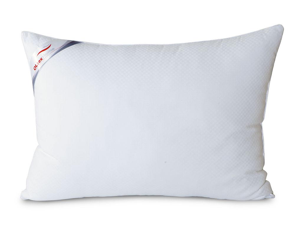 Подушка OL-Tex Богема, 50 х 68 смОЛС-57-1Чехол подушки OL-Tex Богема выполнен из мягкого приятного на ощупь сатина-страйп. Наполнитель - высокосиликонизированное микроволокно OL-tex, которое является усовершенствованным аналогом наполнителя Лебяжий пух.Лебяжий пух - это современный заменитель натурального лебяжьего пуха. Искусственный Лебяжий пух сохраняет непревзойденную мягкость и легкость природного материала, но еще обладает и рядом новых достоинств. Лебяжий пух не вызывает аллергии, в изделиях с таким наполнителем не заводится клещ, бактерии, гнили. За подушками и одеялами очень легко ухаживать - их можно стирать в машинке, они быстро и полностью высыхают.Легкая, почти невесомая подушка, с нежнейшим наполнителем Ol-Tex идеально подходит для сна. Подушка из коллекции Богема обладает прекрасными терморегулирующими свойствами, гиппоаллергенна. Сохраняет форму и объем даже при многократных стирках.Подушка OL-Tex Богема - достойный выбор современной хозяйки!Рекомендации по уходу:- Стирка в теплой воде (температура до 30°С),- Нельзя отбеливать. При стирке не использовать средства, содержащие отбеливатели (хлор),- Сушить вертикально без отжима, - Не гладить. Не применять обработку паром,- Нельзя выжимать и сушить в стиральной машине. Характеристики: Материал чехла: сатин-страйп (100% хлопок). Наполнитель: микроволокно OL-tex. Размер подушки: 50 см х 68 см. Размеры упаковки: 50 см х 60 см х 10 см. Артикул: ОЛС-57-1.УВАЖАЕМЫЕ КЛИЕНТЫ! Обращаем ваше внимание на возможные изменения в цветовом дизайне товара, связанные с ассортиментом продукции. Поставка осуществляется в зависимости от наличия на складе.