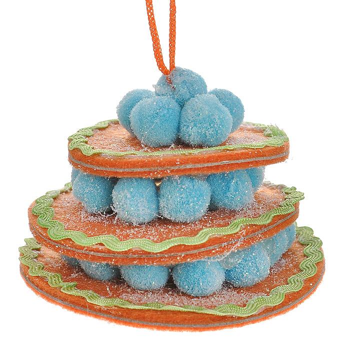 Новогоднее подвесное украшение Торт, цвет: оранжевый. 2536125361Оригинальное подвесное украшение «Торт» прекрасно подойдет для праздничного декора дома и новогодней ели. Украшение выполнено из полиэстера в виде круглого торта и оформлено блестками. С помощью атласной ленточки его можно повесить в любом понравившемся вам месте. Но, конечно, удачнее всего такая игрушка будет смотреться на праздничной елке.Елочная игрушка - символ Нового года. Она несет в себе волшебство и красоту праздника. Создайте в своем доме атмосферу веселья и радости, украшая новогоднюю елку нарядными игрушками, которые будут из года в год накапливать теплоту воспоминаний. Коллекция декоративных украшений из серии Magic Time принесет в ваш дом ни с чем несравнимое ощущение волшебства! Характеристики:Материал: полиэстер. Цвет: оранжевый. Размер украшения: 7 см х 7 см х 5 см. Артикул: 25361.
