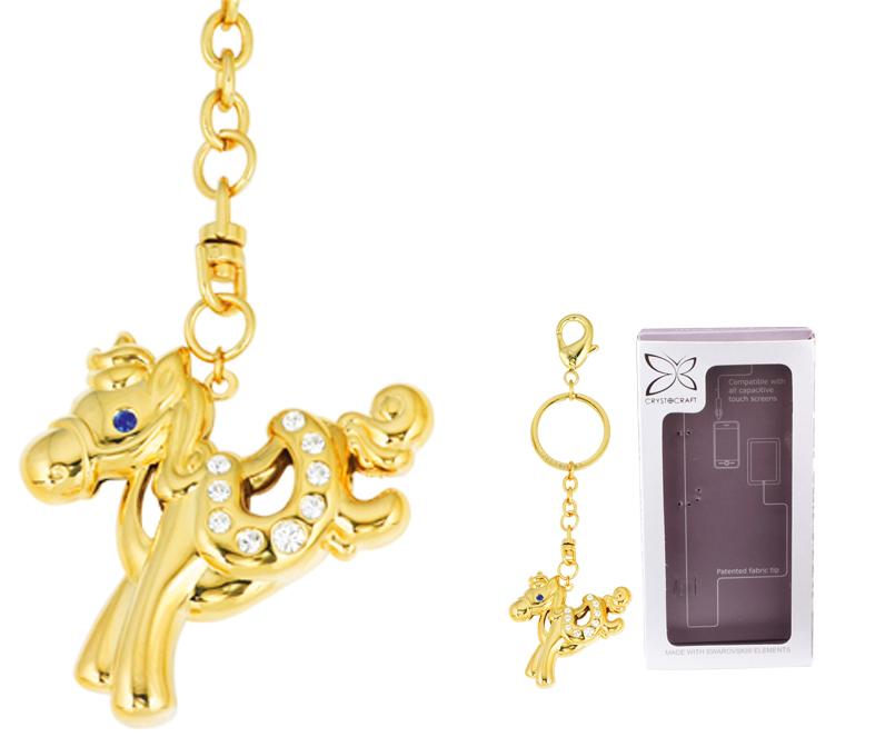 Брелок Crystocraft Лошадка, цвет: золотистыйU0401-161-GC1AИзящный брелок с подвеской в виде лошадки выполнен из золотистого металла и снабжен кольцом для ключей и карабином. Кристаллы, украшающие подвеску, носят громкое имя Swarovski. Ограненные, как бриллианты, кристаллы блистают сотнями тысяч различных оттенков.Эта очаровательная вещица послужит отличным подарком близкому человеку, родственнику или другу, а также подарит приятные мгновения и окунет вас в лучшие воспоминания. Характеристики:Материал: сталь, австрийские кристаллы. Размер подвески:5 см х 4,5 см х 0,8 см. Цвет: золотистый. Размер упаковки: 7 см х 14 см х 2 см. Артикул: U0401-161-GC1A. Более чем 30 лет назад компанияCrystocraftвыросла из ведущего производителя в перспективную торговую марку, которая задает тенденцию благодаря безупречному чувству красоты и стиля. Компания создает изящные, качественные, яркие сувениры, декорированные кристалламиSwarovskiразличных размеров и оттенков, сочетающие в себе превосходное мастерство обработки металлов и самое высокое качество кристаллов. Каждое изделие оформлено в индивидуальной подарочной упаковке, что придает ему завершенный и презентабельный вид.