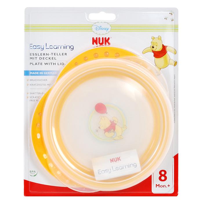Тарелка с крышкой NUK Easy Learning, цвет: желтый10255093Пластиковая тарелочка NUK Easy Learning идеально подойдет для кормления малыша, и самостоятельного приема им пищи. Тарелочка выполнена из прочного безопасного материала и оформлена изображением персонажа мультфильма студии Disney. Наклонный край облегчает ребенку зачерпывание пищи. Благодаря удобным нескользким ручкам тарелку удобно держать во время кормления. Дно дополнено нескользящим кольцом, благодаря чему она не упадет, еда не прольется, а ваш малыш будет доволен. В комплект к тарелке предусмотрена плотно закрывающаяся крышка, которая позволит сохранить остатки еды или поддержать нужную температуру.Размер тарелки (с учетом ручек): 21 см х 19 см х 2,5 см. Внутренний диаметр тарелки: 15 см. Рекомендуемый возраст: от 8 месяцев.