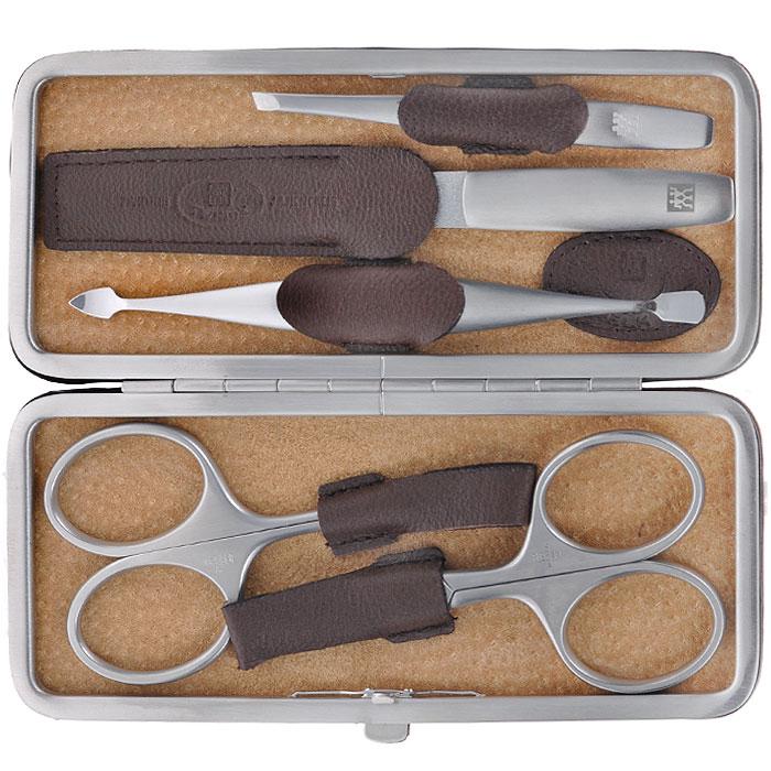 Zwilling Маникюрный набор Twinox, цвет: темно-коричневый, 5 предметов. 97063-00697063-006Маникюрный набор Zwilling Twinox состоит из 5 предметов: ножниц для ногтей, ножниц для кутикулы, скошенного пинцета, пилочки для ногтей и двойного инструмента для отодвигания кутикулы и чистки под ногтями. Инструменты изготовлены из высококачественной нержавеющей стали и хранятся в футляре темно-коричневого цвета из натуральной кожи.Уход: Инструменты предохранять от падения на пол. Время от времени смазывать чистым маслом область соединения, винт, внутреннюю часть и режущие кромки кусачек и ножниц. Использовать только по назначению! Затачивать инструменты у специалиста. Хранить в недоступном для детей месте. Характеристики:Материал: нержавеющая сталь. Длина ножниц для ногтей: 9,5 см. Длина ножниц для кутикулы: 9,5 см. Длина пинцета: 9 см. Общая длина пилочки: 13 см. Длина пилящей поверхности: 6,8 см. Длина маникюрного инструмента: 12,5 см. Материал футляра: металл, натуральная кожа. Размер футляра (ДШВ): 14,5 см х 6 см х 2 см. Размер упаковки (ДШВ): 16,3 см х 9 см х 3 см. Производитель: Германия. Артикул: 97063-006. Товар сертифицирован.Как ухаживать за ногтями: советы эксперта. Статья OZON Гид