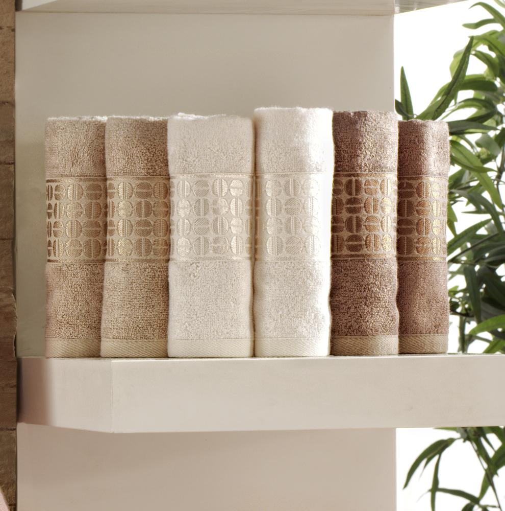 """Набор """"Coffee Bean"""" состоит из шести лицевых махровых полотенец, изготовленных из бамбука. Волокна бамбука придают повышенную мягкость изделию, и обладают высокой степенью поглощения влаги, а также сохраняют свои уникальные свойства после многократных стирок и сушек.  Бамбук - экологически чистый природный материал, который обладает уникальными бактерицидными свойствами, препятствуя проникновению бактерий и запахов. Бамбуковое волокно обладает вентилирующей способностью, обеспечивает гигиену, ограничивает образование пыли и плесени, препятствует образованию запахов. Полотенца оформлены красивым бордюром с орнаментом в виде кофейных зерен.  Такие полотенца подарят массу положительных эмоций и приятных ощущений.   Рекомендации по уходу:  - ручная или машинная стирка при температуре не более 40°С;  - не отбеливать;  - не отжимать на центрифуге;  - химчистка запрещена;  - гладить при температуре не более 110°С.   Характеристики:  Материал: 100% бамбук. Размер: 30 см х 50 см. Плотность: 420 г/м2. Цвет: оттенки коричневого. Комплектация: 6 шт. Размер упаковки: 23 см х 20 см х 6 см. Артикул: Coffee Bean."""