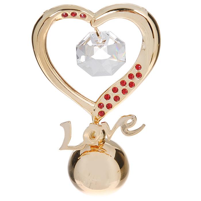 Фигурка декоративная Сердце, цвет: золотистый. 6753867538Декоративная фигурка Сердце выполнена из углеродистой стали, покрытой золотом толщиной 0,05 микрон. Фигурка украшена крупным белым кристаллом и маленькими красными кристаллами Swarovski. Поставьте фигурку на стол в офисе или дома и наслаждайтесь изящными формами и блеском кристаллов.Изысканный и эффектный, этот сувенир покорит своей красотой и изумительным качеством исполнения, а также станет замечательным подарком. Характеристики:Материал: углеродистая сталь, кристаллы Swarovski. Размер фигурки (ДхШхВ): 5 см х 2,5 см х 8,5 см. Цвет: золотистый. Размер упаковки: 6,5 см х 4,5 см х 9 см. Артикул: 67538.