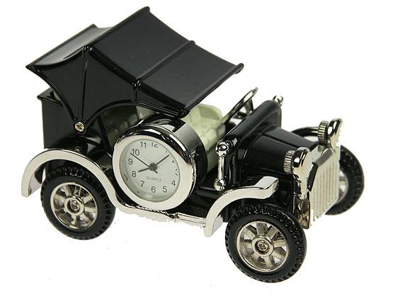 Часы настольные Ретро автомобиль, цвет: черный, серебристый. 2242022420Оригинальный дизайн настольных часов Ретро автомобиль разработан с учетом современных тенденций оформления интерьеров. Выполненные из металлического сплава в виде старинного авто, эти часы, несомненно, будут привлекать к себе внимание. Колеса и крыша машины подвижны.Часы с кварцевым механизмом работают плавно и бесшумно и требуют лишь примерно раз в год замены батарейки. На циферблате имеются часовая, минутная и секундная стрелки. Такие часы легко впишутся в любой интерьер и станут великолепным подарком! Характеристики: Материал: металл (сплав цинка), стекло.Общий размер (ДхШхВ): 8,5 см х 5,5 см х 6 см.Размер корпуса часового механизма: 2,5 см х 2,5 см х 1,6 см.Диаметр циферблата: 1,7 см.