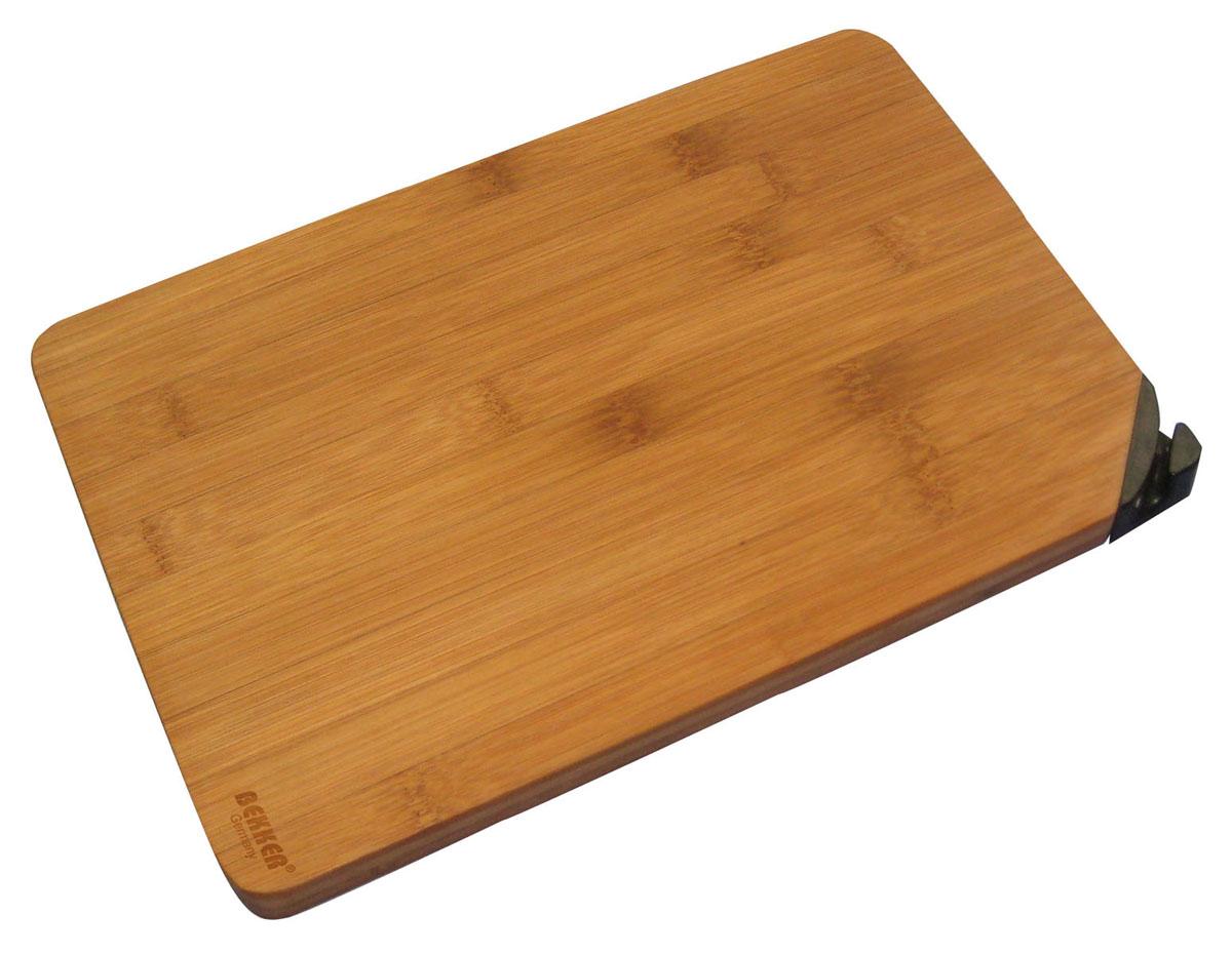 """Разделочная доска """"Bekker"""" изготовлена из высококачественной древесины бамбука, обладающей антибактериальными свойствами. Бамбук - инновационный материал, идеально подходящий для разделочных досок. Доски из бамбука обладают высокой плотностью структуры древесины, а также устойчивы к механическим воздействиям. Угол доски оснащен заточкой для ножа. Функциональная и простая в использовании, разделочная доска """"Bekker"""" прекрасно впишется в интерьер любой кухни и прослужит вам долгие годы.   Характеристики: Материал: бамбук. Размер доски: 34 см х 24 см х 2 см. Артикул: BK-9729."""