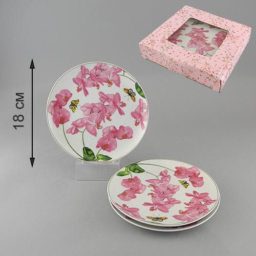 Набор тарелок Орхидея, диаметр 18,5 см, 3 шт545-664Набор Орхидея состоит из трех тарелок, выполненных из высококачественного фарфора и украшенных изображением цветков орхидеи и бабочек. Тарелки имеют изящную форму и декорированы золотистой окантовкой. Такой набор тарелок настроит на позитивный лад и подарит хорошее настроение. Стильный изящный дизайн несомненно придется вам по вкусу. Набор тарелок упакован в стильную подарочную коробку из плотного картона. Характеристики: Материал:фарфор. Диаметр тарелки:18,5 см. Комплектация:3 шт. Размер упаковки:19 см х 19 см х 4 см. Производитель:Китай. Артикул:545-664.
