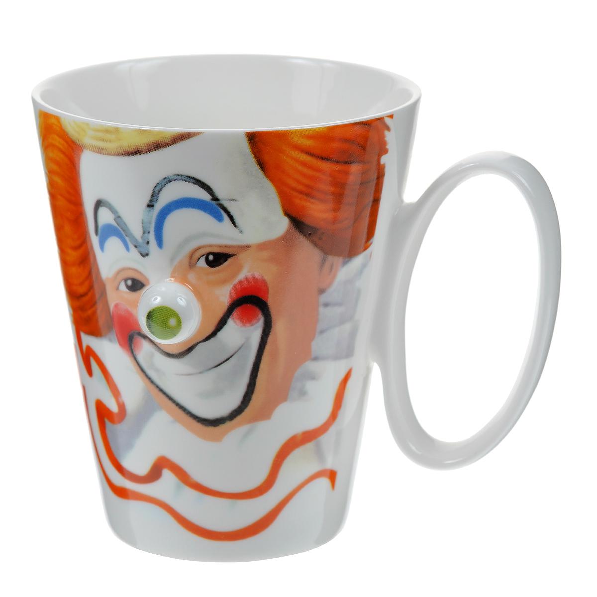 """Оригинальная кружка """"Клоун"""" выполнена из керамики и оформлена забавным изображением клоуна с выступающим зеленым носом. Такая кружка станет не только приятным, но и практичным сувениром. Характеристики:  Материал:  керамика. Высота кружки:  10 см. Диаметр по верхнему краю: 8,5 см. Размер упаковки:  11,5 см х 9,5 см х 11 см. Артикул:003427."""