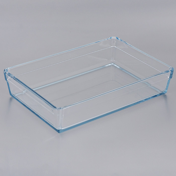 Лоток для СВЧ Pasabahce Borcam Premium, прямоугольный, 28,5 см х 19,5 см. 5932459324Прямоугольный лоток для СВЧ Pasabahce Borcam Premium выполнен из жаропрочного стекла.Стекло - самый безопасный для здоровья материал. Посуда из стекла не вступает в реакцию с готовящейся пищей, а потому не выделяет никаких вредных веществ, не подвергается воздействию кислот и солей. Из-за невысокой теплопроводности пища в ней гораздо медленнее остывает. Стеклянная посуда очень удобна для приготовления и подачи самых разнообразных блюд: супов, вторых блюд, десертов. Благодаря прозрачности стекла, за едой можно наблюдать при ее готовке, еду можно видеть при подаче, хранении. Используя такую посуду, вы можете как приготовить пищу, так и изящно подать ее к столу, не меняя посуды. Благодаря гладкой идеально ровной поверхности посуда легко моется. Можно использовать в духовках, микроволновых печах и морозильных камерах (выдерживает температуру от - 30°C до 300°C). Можно мыть в посудомоечной машине. Характеристики: Материал: жаропрочное стекло. Размер лотка: 28,5 см х 19,5 см. Высота стенки: 6 см. Размер упаковки: 36 см х 27 см х 7 см. Артикул: 59324.