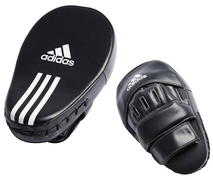 Лапы Adidas Training Curved Focus Mitts Long, цвет: черныйadiBAC02Профессиональные боксерские лапы Adidas Training Curved Focus Mitts Long предназначены для занятий боксом и единоборствами, прекрасно подходят для отрабатывания ударов.Лапы с закругленными краями выполнены из мягкой искусственной кожи черного цвета. Ударопрочный пенный наполнитель высокой плотности имеет изогнутую форму. Удобное крепление в виде наружной перчатки, надежно поддерживающее запястье, убережет суставы рук от травм.
