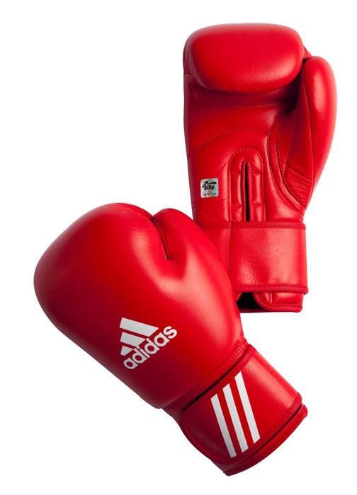 Боксерские перчатки Adidas AIBA разработаны и спроектирован для обеспечения максимальной защиты. Перчатки сертифицированы Международной ассоциацией бокса (AIBA). Оболочка  перчаток изготовлена из натуральной кожи, что увеличивает срок эксплуатации. Внутреннее наполнение из  пены, изготовленной по технологии Air Cushion, обеспечивает отличную амортизацию ударных нагрузок. Фиксация манжеты с помощью эластичной застежки велкро.