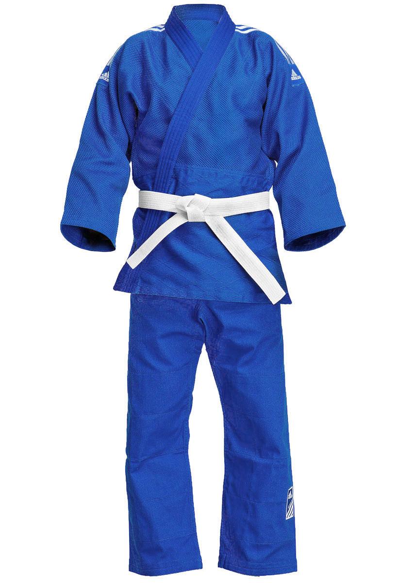 Кимоно для дзюдо adidas Contest, цвет: синий. J650B. Размер 160J650BКимоно для дзюдо adidas Contest состоит из рубашки и брюк. Просторная рубашка с запахом, боковыми разрезами и длинными рукавами-кимоно изготовлена из плотного хлопка с добавлением полиэстера с перекрестным плетением. Боковые швы, края рукавов и полочек, низ рубашки укреплены дополнительными строчками и крепкой лентой с внутренней стороны. Рубашка также укреплена по вертикали спины и в области талии. Просторные брюки особого покроя на поясе со шнурком для фиксации брюк на талии имеют шлевки для дополнительного пояса и укреплены на коленях. Кимоно рекомендуется для тренировок в зале.