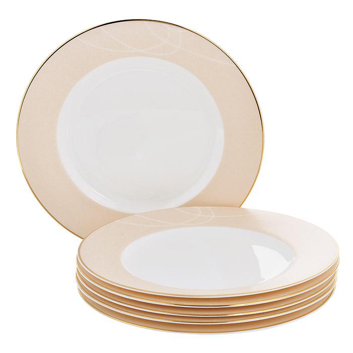 Набор десертных тарелок Esprado El Gracio, диаметр 20 см, 6 штEG40B20E301Набор Esprado El Gracio состоит из шести десертных тарелок, выполненных из костяного фарфора. Основная составляющая костяного фарфора - костная зола и каолин. От содержания костной золы зависит белизна и прозрачность фарфора, который может содержать до 50% костяной золы. Родина костной золы, из которой производится посуда Esprado, - Великобритания, славящаяся сырьем высокого качества. Каолин, белая глина на основе природного минерала, поступает из Новой Зеландии, одного из наиболее экологически чистых регионов мира. Такое сочетание обеспечивает высокое качество материала и безупречный оттенок слоновой кости.В костяном фарфоре отсутствуют примеси кадмия и свинца, а потому он абсолютно нетоксичен и безопасен. Экологическая глазурь из Японии, высоко ценящаяся во всем мире, которой покрывается готовое изделие, позволяет добиться идеально ровного цвета и кристального блеска. При декорировании использованы драгоценные металлы, в том числе платина и золото. Изделия серии El Gracio украшены золотой деколью. Посуда имеет классическую форму с бортиками.Посуда из фарфора Esprado прочна и устойчива к истиранию: царапины от ножа и сеточки трещин не появятся на ней даже через несколько лет. Характерные для коллекции El Gracio особенности - асимметрия и плавно изогнутые золотые линии, кажущиеся еще ярче и выразительнее на белом и пастельном фоне, благодаря чему посуда этой серии получилась легкой и воздушной. Каждый предмет отличается своей уникальной деколью, собранные же воедино они образуют оригинальный обеденный сервиз для самых взыскательных и утонченных. Столовая посуда El Gracio придаст особую неповторимость вашему столу.Запрещается использовать в микроволновой печи, мыть в посудомоечной машине и использовать абразивные моющие средства.