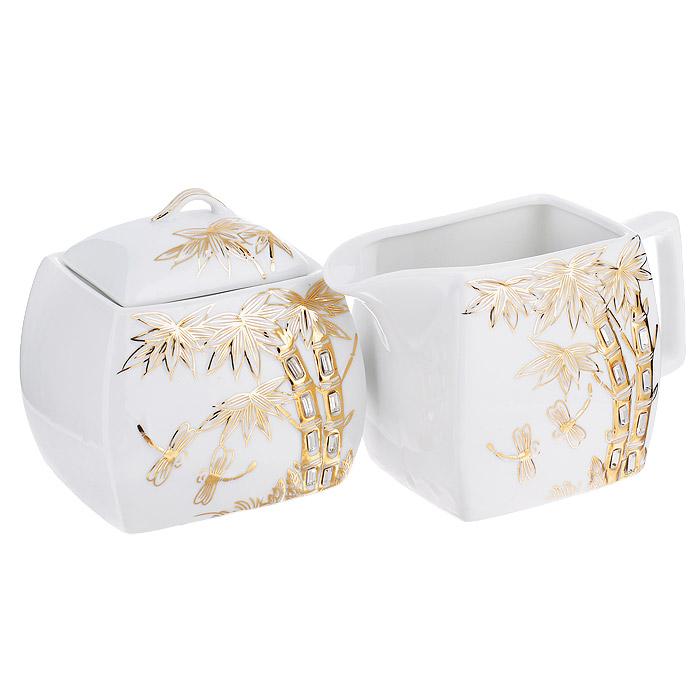 Набор чайный Briswild Золотые пальмы, 2 предмета595-214Набор Briswild Золотые пальмы, выполненный из высококачественного фарфора белого цвета, состоит из сахарницы с крышкой и молочника. На предметах набора изображены пальмы со стрекозами, оформленные золотистой эмалью в сочетании со стразами. Изящный дизайн оформления набора придется по вкусу и ценителям классики, и тем, кто предпочитает утонченность и изысканность. Такой набор отлично подойдет для красивой сервировки стола к завтраку. Не использовать в микроволновой печи. Не применять абразивные чистящие вещества.