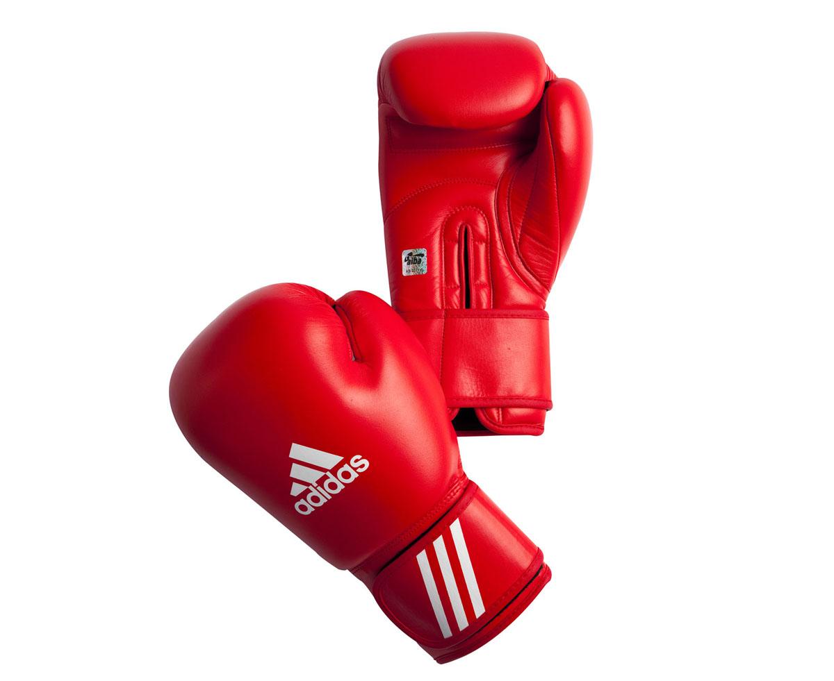 Перчатки боксерские Adidas Aiba, цвет: красный. AIBAG1. Вес 12 унцийAIBAG1Боксерские перчатки Adidas AIBA разработаны и спроектирован для обеспечения максимальной защиты. Перчатки сертифицированы Международной ассоциацией бокса (AIBA). Оболочка перчаток изготовлена из натуральной кожи, что увеличивает срок эксплуатации. Внутреннее наполнение из пены, изготовленной по технологии Air Cushion, обеспечивает отличную амортизацию ударных нагрузок. Фиксация манжеты с помощью эластичной застежки велкро.