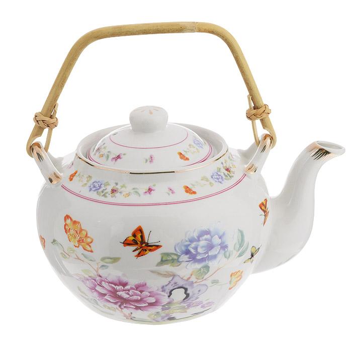 Чайник заварочный Briswild Цветочная долина, с бамбуковой ручкой, 920 мл523-107Чайник заварочный Briswild Цветочная долина изготовлен из высококачественного фарфора белого цвета, украшенного изящным изображением цветов и бабочек. К чайнику прилагается ручка из натурального бамбука. Такой интересный дизайн, несомненно, придется по вкусу и любителям классики, и тем, кто ценит красоту и изящество. Чайник заварочный Briswild Цветочная долина украсит ваш кухонный стол, а также станет замечательным подарком к любому празднику. Не использовать в микроволновой печи. Не применять абразивные чистящие вещества.Диаметр по верхнему краю: 8,5 см. Диаметр основания чайника: 9 см.Высота чайника (без учета крышки): 10 см.