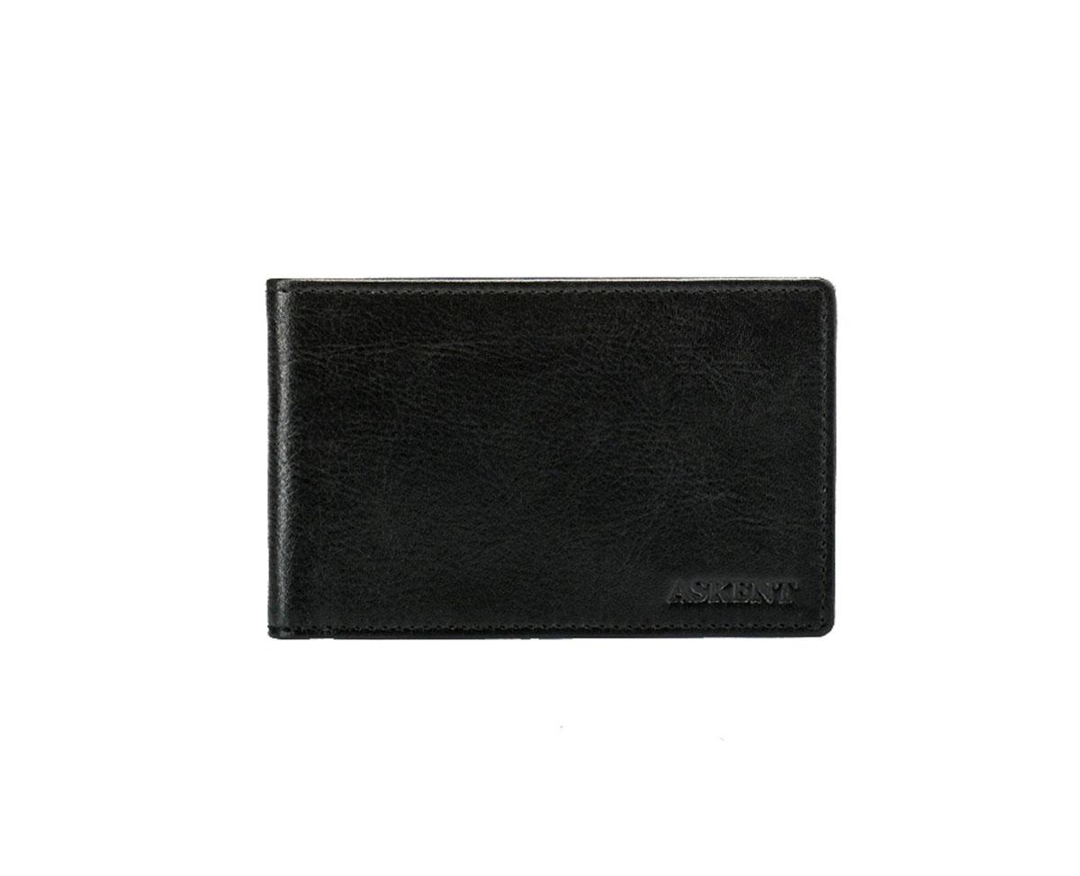 Визитница горизонтальная Askent, цвет: черный. V.1.MN21/0525/117Модная горизонтальная визитница Askent изготовлена из натуральной кожи и исполнена в лаконичном стиле. Лицевая сторона оформлена тисненым названием бренда. Внутри содержится съемный блок из прозрачного мягкого пластика на 20 визиток, а также 2 удобных боковых кармана.Изделие упаковано в фирменную коробку.Стильная визитница подчеркнет вашу индивидуальность и отменный вкус, а также станет замечательным подарком человеку, ценящему качественные и практичные вещи.