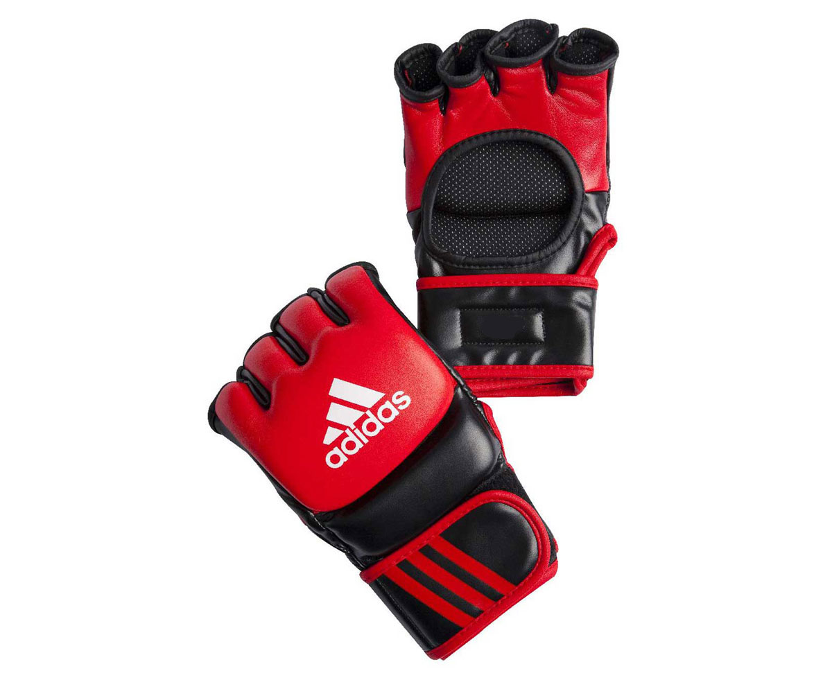 Перчатки для смешанных единоборств Adidas Ultimate Fight, цвет: черный, красный. Размер SadiCSG041Боевые перчатки Adidas Ultimate Fight предназначены для занятий смешанными единоборствами. Они изготовлены из натуральной воловьей кожи с черными вставками из вспененного полимера. Внутренняя часть выполнена с использованием технологии I-Comfort+, благодаря чему перчатки быстро высыхают, не скользят по руке и не вызывают аллергии. Застежка на липучке способствует быстрому и удобному одеванию перчаток, плотно фиксирует перчатки на руке. Одобрены UFC.