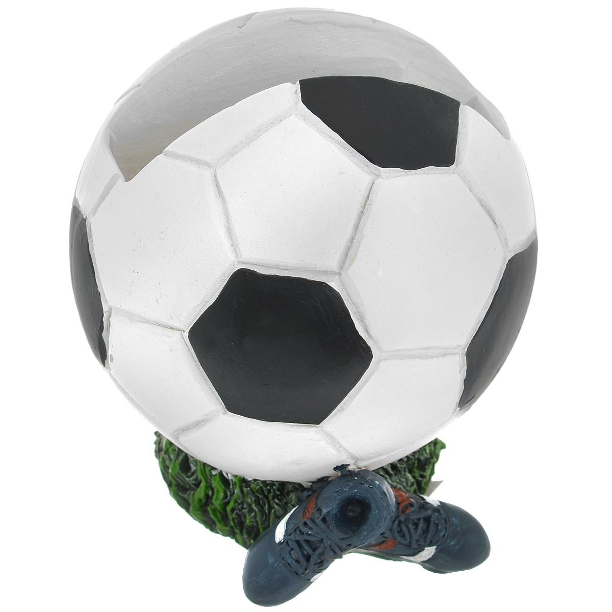 Подставка для мобильного телефона Футбол. 2893428934Подставка для мобильного телефона Футбол выполнена из пластмассы в виде футбольного мяча.Яркая оригинальная подставка прекрасно подойдет для безопасного хранения мобильного телефона. С ней ваш телефон всегда будет на виду.