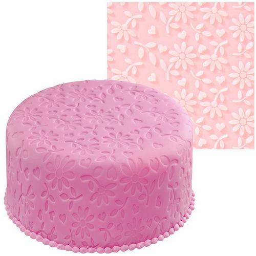 Мат для нанесения рисунка на мастику Wilton Цветочная фантазия, цвет: розовый, 50,8 см х 50,8 смWLT-409-415Мат Wilton Цветочная фантазия, изготовленный из силикона, предназначен для нанесения рисунка на мастику при украшении тортов. Изделие имеет тиснение в виде различных цветов.С этим матом вы сможете легко украсить кондитерское изделие.