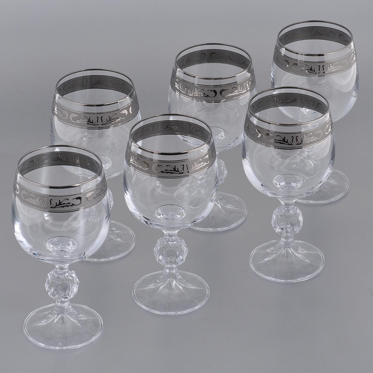 Набор бокалов для вина Crystalite Bohemia Клаудия, 190 мл, 6 шт. 40149/190/378500K40149/190/378500KНабор Crystalite Bohemia Клаудия состоит из шести бокалов, выполненных из прочного выдувного высококачественного стекла. Изящные бокалы, декорированные серебристой окантовкой и красивым орнаментом, прекрасно подойдут для подачи вина. Они излучают приятный блеск и издают мелодичный звон. Бокалы сочетают в себе элегантный дизайн и функциональность. Благодаря такому набору пить напитки будет еще вкуснее.Набор Crystalite Bohemia Клаудия прекрасно оформит праздничный стол и создаст приятную атмосферу за романтическим ужином. Такой набор также станет хорошим подарком к любому случаю. Не использовать в посудомоечной машине и микроволновой печи.