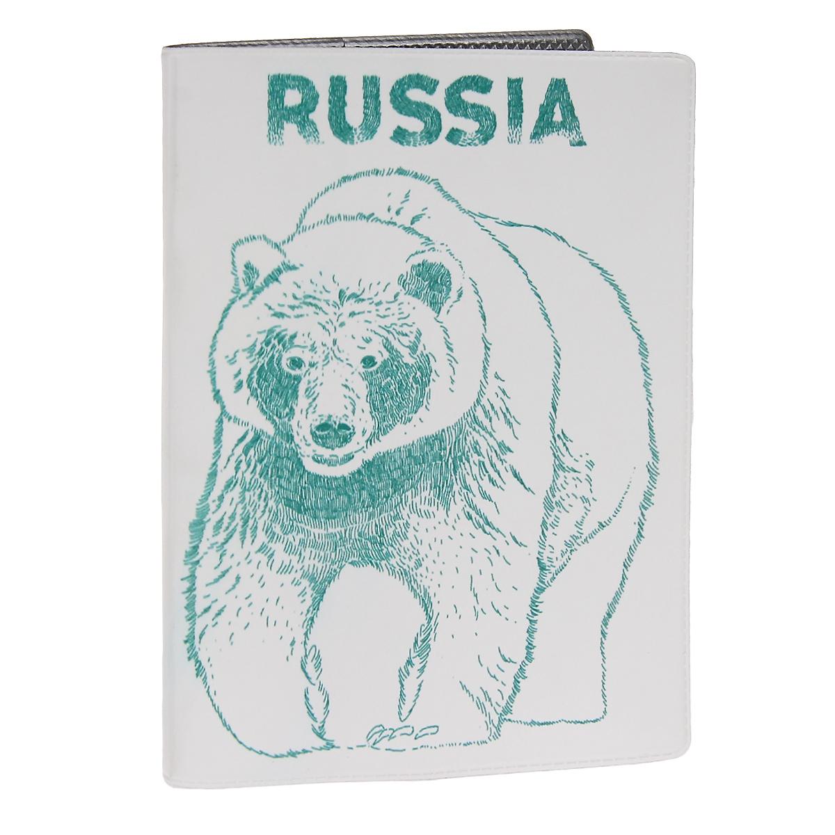 Обложка для автодокументов Медведь. AUTOZAM302AUTOZAM302Обложка для автодокументов Mitya Veselkov Медведь изготовлена из прочного ПВХ белого цвета и оформлена изображением в виде медведя и надписью Russia. На внутреннем развороте имеются съемный блок из шести прозрачных файлов из мягкого пластика для водительских документов, один из которых формата А5, а также два боковых кармашка для визиток или банковских карт.Стильная обложка не только поможет сохранить внешний вид ваших документов и защитит их от грязи и пыли, но и станет аксессуаром, который подчеркнет вашу яркую индивидуальность.