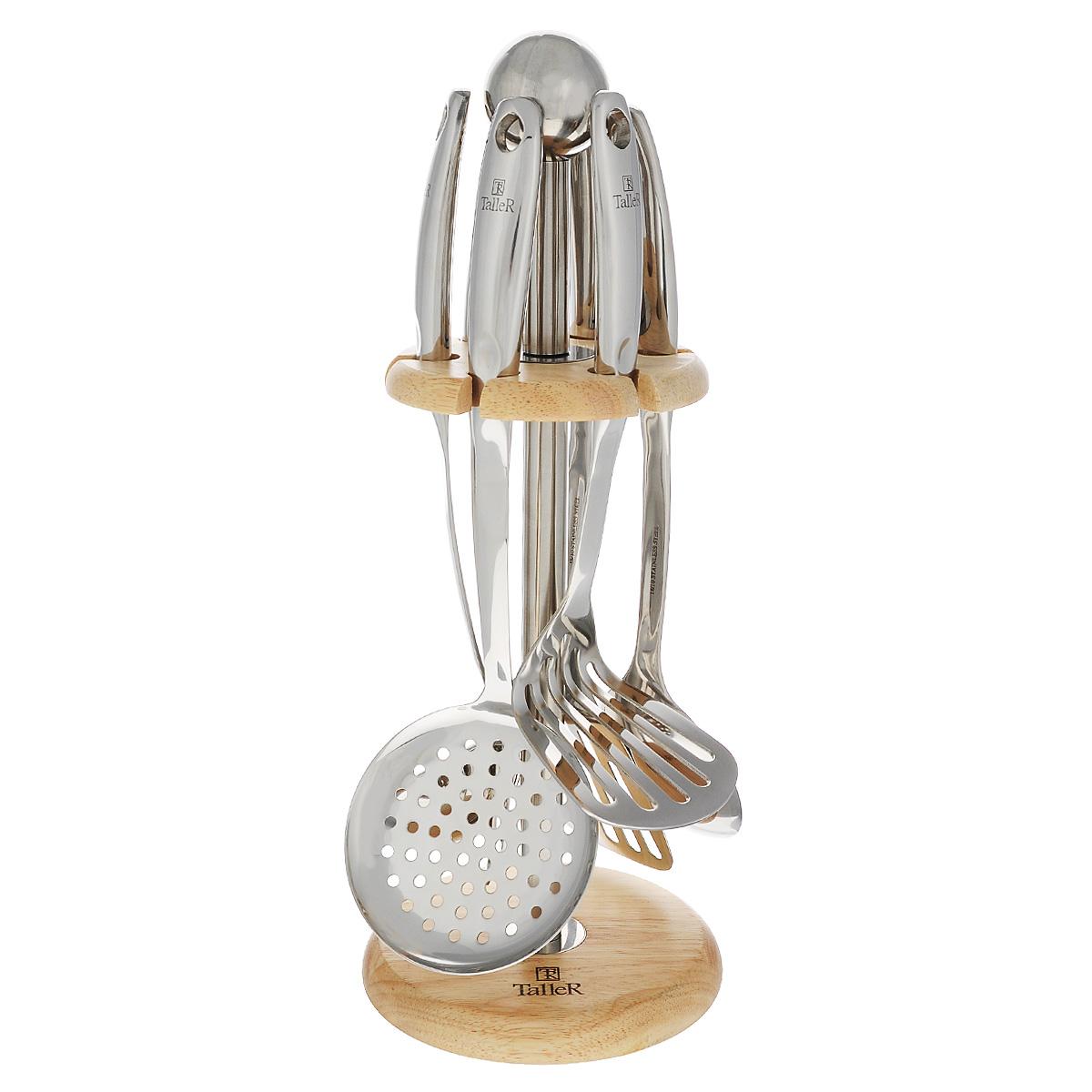 Набор кухонных принадлежностей Taller Колдвел, 7 предметовTR-1406Набор кухонных принадлежностей Taller Колдвел включает в себя: картофелемялку, половник, ложку поварскую, шумовку, вилку поварскую, лопатку перфорированную, подставку. Предметы набора выполнены из высококачественной нержавеющей стали 18/10 и оснащены ручками с отверстиями на конце, благодаря которым, вы сможете их подвесить на подставку или в любое для вас удобное место. Подставка выполнена из нержавеющей стали и дерева. Эксклюзивный дизайн, эстетичность и функциональность набора Taller Колдвел позволят ему занять достойное место среди кухонного инвентаря. Можно мыть в посудомоечной машине.