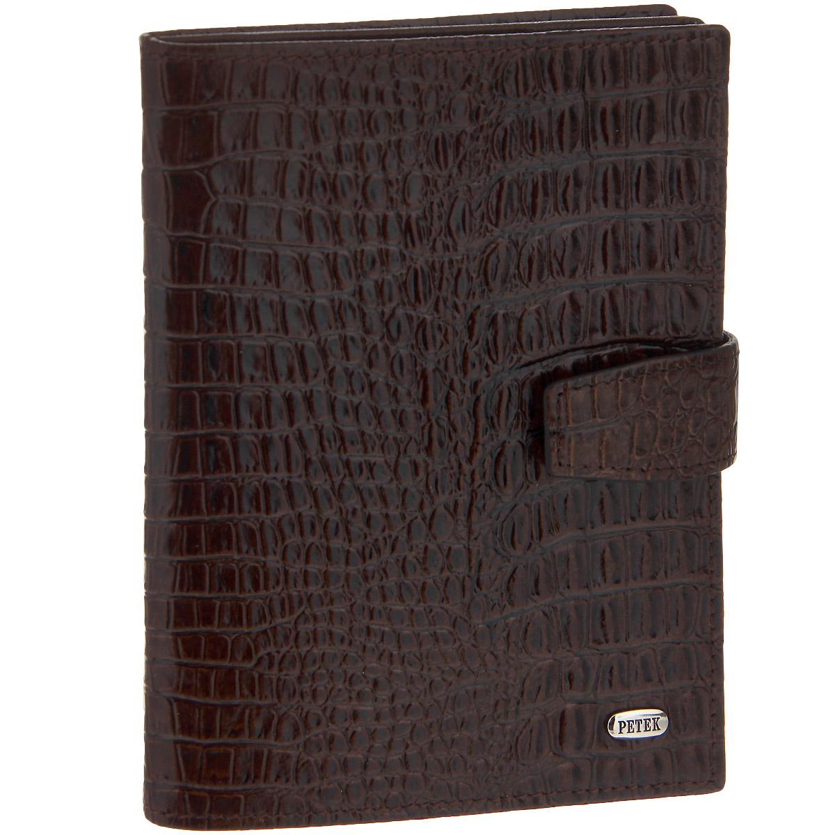 Обложка для паспорта и автодокументов Petek, цвет: коричневый.595.067.02Натуральная кожаЭффектная обложка для паспорта и автодокументов Petek выполнена из натуральной кожи коричневого цвета и декорирована тиснением под кожу рептилии. На лицевой стороне изделие оформлено небольшой металлической пластиной с гравировкой Petek, на внутренней стороне - тиснением в виде названия бренда. Обложка закрывается хлястиком на застежку-кнопку. Модель состоит из двух отделений. Первое предназначено для паспорта и содержит два удобных боковых кармана, которые обеспечат надежную фиксацию вашего документа. Второе - для автодокументов, содержит съемный блок из шести прозрачных файлов из мягкого пластика, один из которых формата А5, а также два боковых прозрачных кармашка. Изделие упаковано в фирменную коробку.Стильная обложка для паспорта и автодокументов не только поможет сохранить их внешний вид и защитить от повреждений, но и станет аксессуаром, который внесет изюминку в ваш образ.