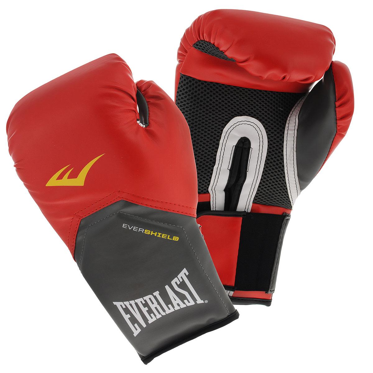 Перчатки тренировочные Everlast Pro Style Elite, цвет: красный, 14 унций2114EEverlast Pro Style Elite — тренировочные боксерские перчатки для спаррингов и работы на снарядах. Изготовлены из качественной искусственной кожи с применением технологий Everlast, использующихся в экипировке профессиональных спортсменов. Благодаря выверенной анатомической форме перчатки надежно фиксируют руку и гарантируют защиту от травм. Нижняя часть, полностью изготовленная из сетчатого материала, обеспечивает циркуляцию воздуха и препятствует образованию влаги, а также неприятного запаха за счет антибактериальной пропитки EVERFRESH. Комбинация легких дышащих материалов поддерживает оптимальную температуру тела. Модель подходит для начинающих боксеров, которые хотят тренироваться с экипировкой высокого класса.