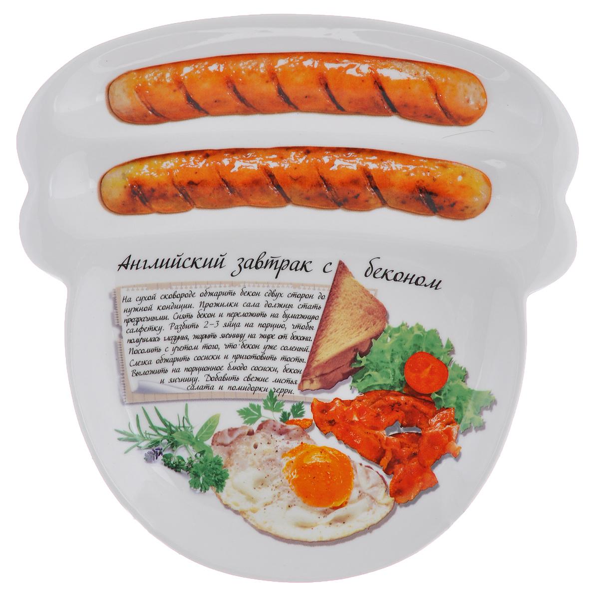 Блюдо для сосисок Larangе Английский завтрак с беконом, 23 см х 22,7 см х 1,6 см598-077Блюдо для сосисок Larange Английский завтрак с беконом изготовлено из высококачественной керамики. Изделие украшено изображением двух сосисок и рецепта английского завтрака с беконом. Тарелка имеет три отделения: два маленьких отделения для сосисок и одно большое отделение для яичницы или другого блюда. В комплект входят лучшие рецепты от шефа. Можно использовать в СВЧ печах, духовом шкафу, холодильнике. Можно мыть в посудомоечной машине. Не применять абразивные чистящие вещества. Размер блюда: 23 см х 22,7 см х 1,6 см.