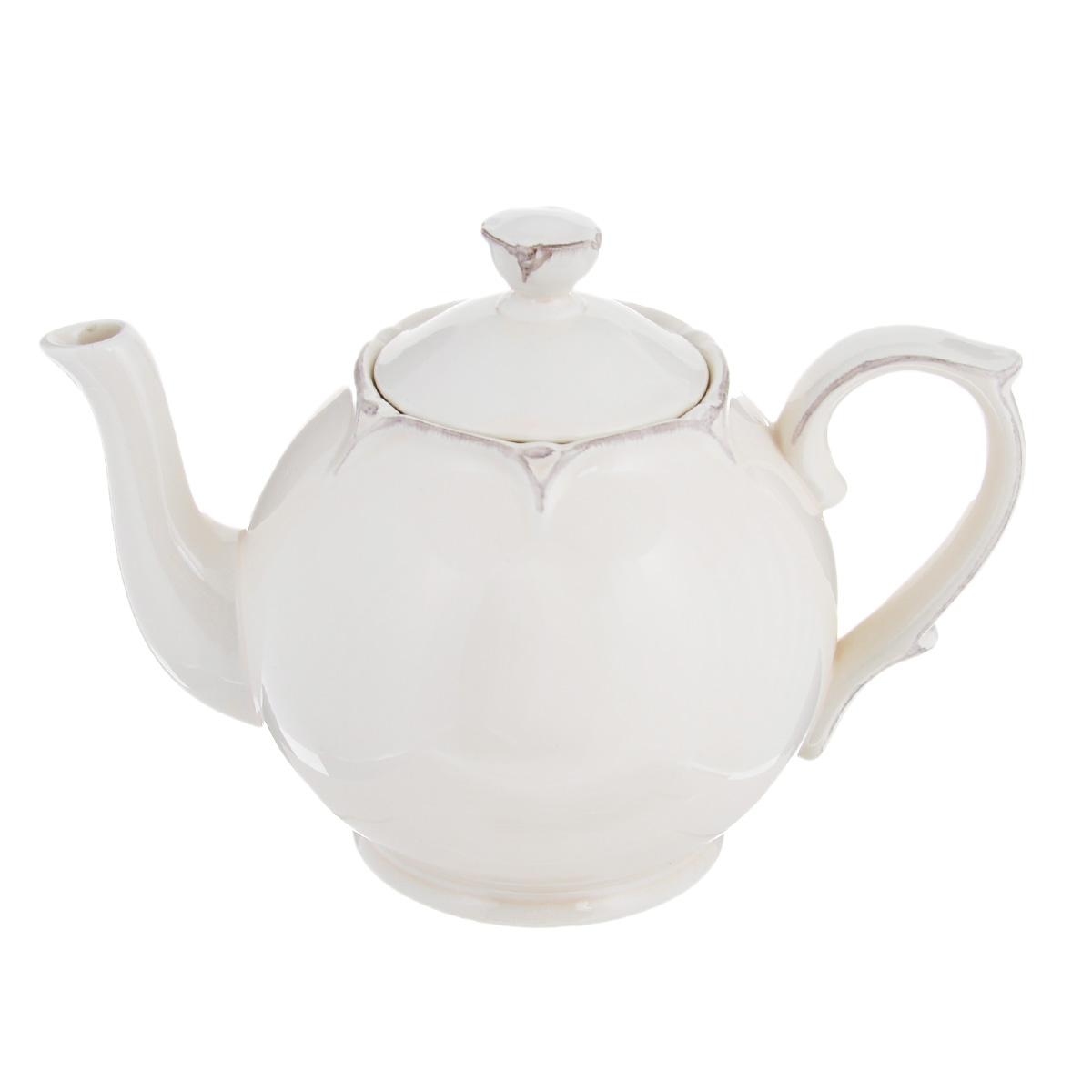 Чайник заварочный Lillo Ideal, цвет: молочный, 1 л214198Чайник заварочный Lillo Ideal изготовлен из высококачественной керамики. Чайник станет отличным дополнением к вашему кухонному инвентарю, а также украсит сервировку стола и подчеркнет прекрасный вкус хозяина.Можно использовать в посудомоечной машине и микроволновой печи. Диаметр чайника (по верхнему краю): 6,5 см.Диаметр основания чайника: 8,5 см.Высота чайника (без учета крышки и ручки): 12,5 см.Объем чайника: 1 л.