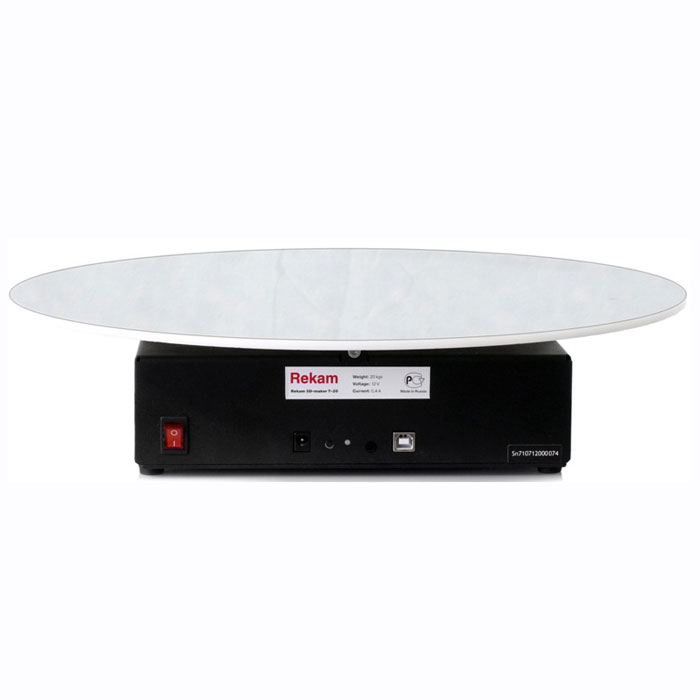 Rekam Т-20 стол предметный для 3D фотосъемкиТ-20Поворотная платформа для предметной фотосъемки Rekam 3D-maker Т-20 является удобным решением для применения в студиях. Столик имеет увеличенный диаметр диска и улучшенную механику, что позволяет снимать более тяжелые объекты, которые невозможно снять при помощи стола Rekam 3D-maker Т-12. При этом вес самого столика позволяет использовать его не только как стационарный студийный вариант, но и на выездной фотосъемке.Нагрузочная способность данного стола составляет 20кг, что позволяет снимать как небольшие предметы типа мобильных телефонов, так и более крупные, такие, как мониторы, небольшая офисная техника, цветы.