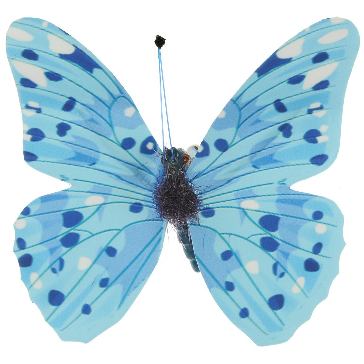 """Декоративный элемент Hobby Time """"Бабочка"""", изготовленный из текстиля, предназначен для декорирования. Он может пригодиться в оформлении одежды, предметов интерьера, подарков, цветочных букетов, а также в скрапбукинге. Изделие выполнено в виде яркой бабочки, декорированной оригинальным узором. С оборотной стороны бабочка оснащена металлической клипсой."""