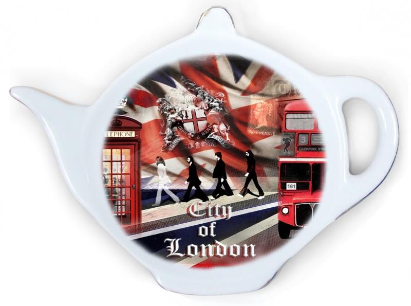 Подставка для чайных пакетиков GiftnHome Лондонские фантазииTB-LondonПодставка для чайных пакетиков GiftnHome Лондонские фантазии, изготовленная из фарфора, порадует вас оригинальностью и дизайном. Подставка выполнена в форме чайничка и декорирована ярким цветным изображением улицы Лондона.Подставка, несомненно, понравится любой хозяйке, а кухонный стол всегда будет чистым, без нежелательных разводов от чайных пакетиков.Размер подставки: 11,5 см х 8,5 см х 2 см.