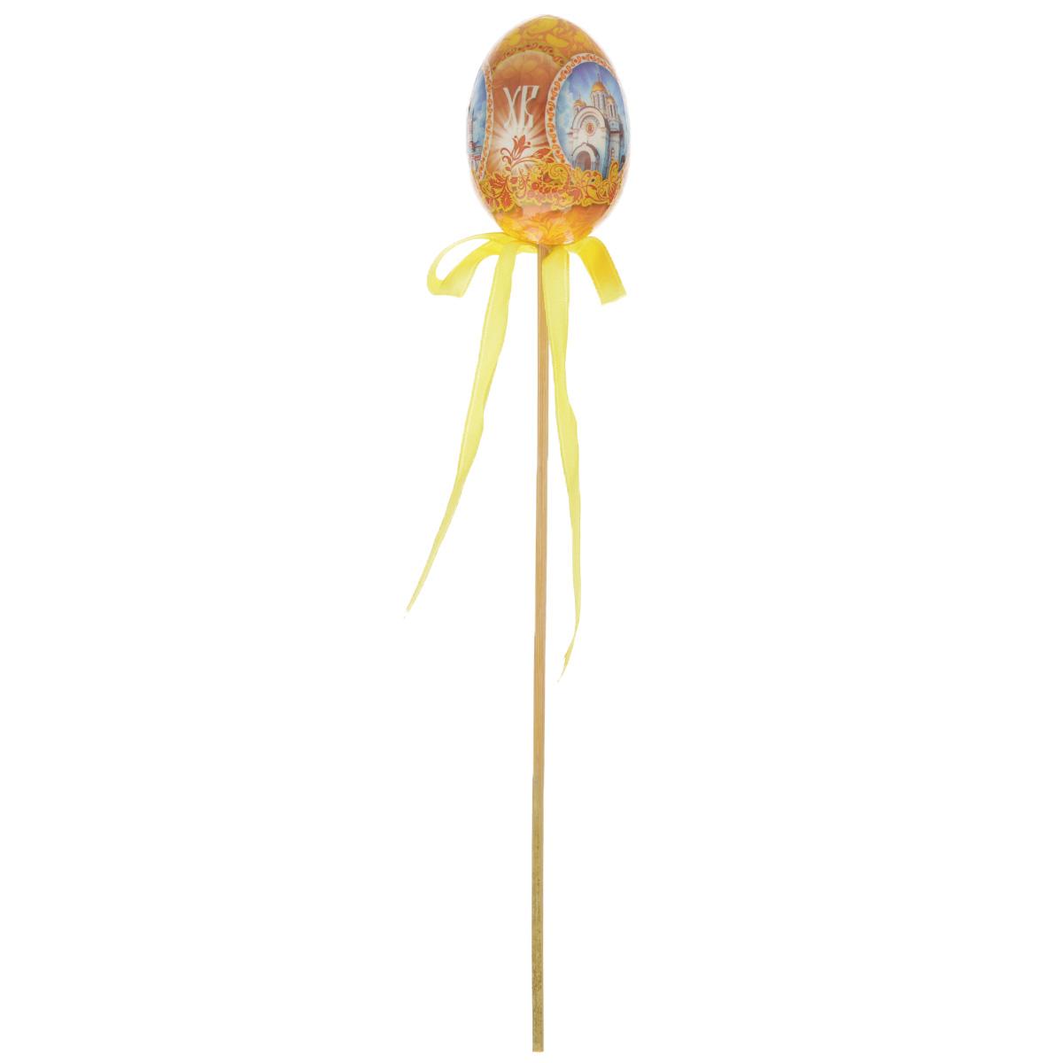 Декоративное украшение на ножке Home Queen Храмы, цвет: желтый, высота 26 см66756_1Декоративное украшение Home Queen Храмы выполнено из пластика в виде пасхального яйца на деревянной ножке, декорированного изображениями храмов. Изделие украшено текстильной лентой.Такое украшение прекрасно дополнит подарок для друзей или близких. Высота: 26 см. Размер яйца: 6,5 см х 4,5 см.
