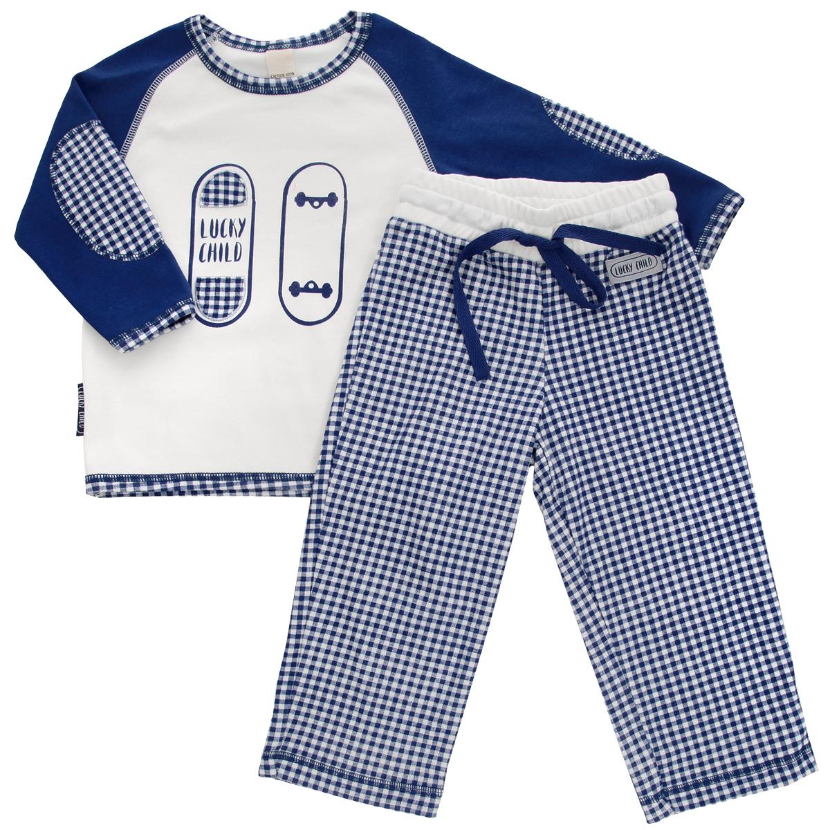 Пижама для мальчика Lucky Child, цвет: синий, молочный. 13-401. Размер 128/13413-401Очаровательная пижама для мальчика Lucky Child, состоящая из футболки с длинным рукавом и брюк, идеально подойдет вашему маленькому мужчине и станет отличным дополнением к детскому гардеробу. Изготовленная из натурального хлопка - интерлока, она необычайно мягкая и приятная на ощупь, не раздражает нежную кожу ребенка и хорошо вентилируется, а эластичные швы приятны телу и не препятствуют его движениям.Футболка с длинными рукавами-реглан и круглым вырезом горловины оформлена спереди оригинальной аппликацией и принтом с изображением скейтборда. Горловина, рукава и низ изделия оформлены принтом в клетку. Рукава украшены декоративными заплатами. Брюки на талии имеют широкий эластичный пояс со шнурком, благодаря чему они не сдавливают животик ребенка и не сползают. Оформлены брюки принтом в клетку и небольшой нашивкой с названием бренда. Такая пижама идеально подойдет вашему ребенку, а мягкие полотна позволят ему комфортно чувствовать себя во время сна!