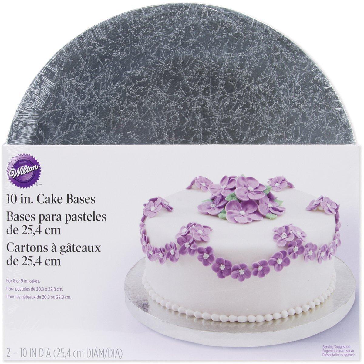 Набор подставок для торта Wilton, диаметр 25,4 см, 2 штWLT-2104-1187Набор Wilton включает две круглые подставки для торта, выполненные из гофрокартона с жироустойчивым покрытием. Подставки достаточно надежные, чтобы выдержать довольно тяжелый торт с большим количеством украшений. Идеальны для любых видов тортов. Диаметр подставок идеален, чтобы украсить торт по краю кремовыми жемчужинами или ленточками.С такими подставками вы всегда сможете красиво оформить вашу выпечку.Диаметр подставки: 25,4 см. Толщина подставки: 1,5 см.