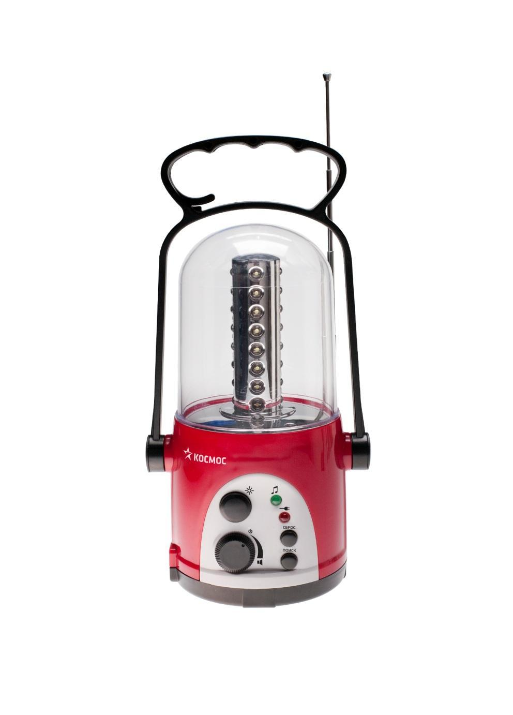 Кемпинговый светодиодный фонарь c радио КОС Ac6010 LED radioKOCAc6010LED_radio Кемпинговый фонарь Космос - это инновационный продукт, сочетающий в себе последние достижения электротехники и эргономики. Он прекрасно подойдет для использования на отдыхе в палатке или на даче. Фонарь имеет надежную ударопрочную конструкцию из пластика и защищен от попадания песка, пыли и влаги внутрь. Он снабжен 32 яркими и экономичными LED элементами. Они не перегорают и не требуют замены. Включение и выключение фонаря происходит при помощи специального переключателя. Фонарь имеет встроенное зарядное устройство и индикацию процесса зарядки. Благодаря удобной складной ручкой-трансформер фонарь можно использовать не только для настольной работы, но и переносить с места на место и освещать объекты на земле. Функция крючка позволяет подвешивать фонарь в качестве источника света внутри помещения и палаток. Фонарь укомплектован сетевым шнуром для подзарядки. Материал: пластик; цвет: красный; размер (см): 11 х 10,5 х 24
