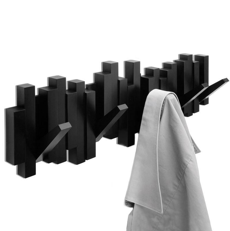 """Стильная и прочная вешалка Umbra """"Sticks"""" интересной формы и оригинального дизайна изготовлена из прочного пластика. Имеет 5 откидных и прочных крючков. Когда они не используются, то складываются, превращая конструкцию в плоский декоративный элемент стильной формы. Вешалка Umbra """"Sticks"""" идеально подходит для маленьких прихожих и ограниченных пространств. Каждый крючок выдерживает вес до 2,3 кг. Размер вешалки: 50 см х 17 см х 2 см."""