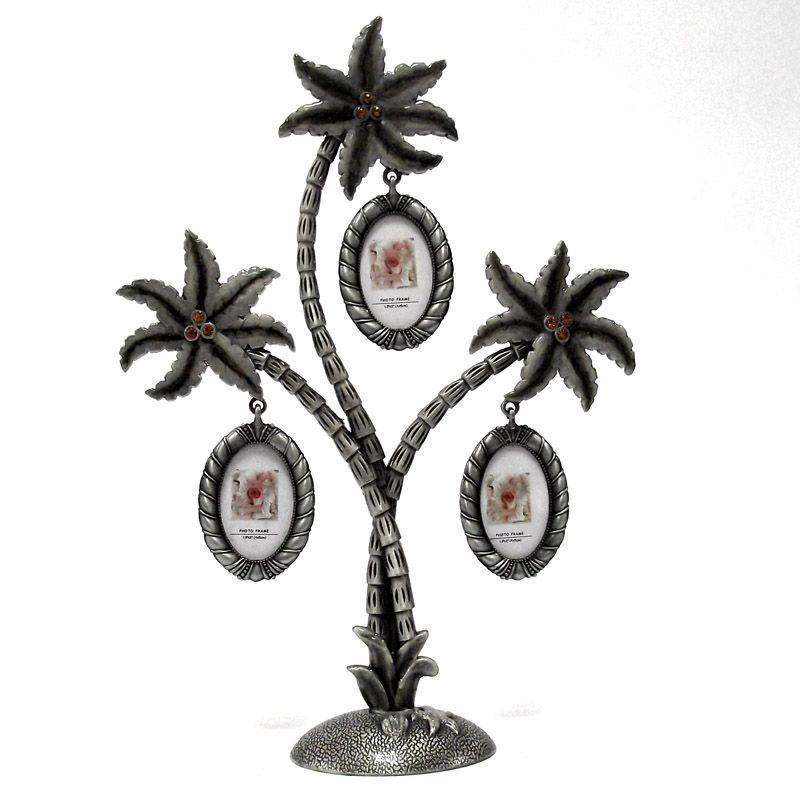 Металлическая фоторамка Пальма, на 3 фотографий. 9471894718Оригинальная рамка для фотографий выполнена в виде пальмы, на ветвях которого прикреплены небольшие рамочки овальной формы. На такой пальме вы сможете разместить фото всей своей семьи. Рамка выполнена из металла серебристого цвета и украшена декоративной эмалью и стразами.Такая рамка послужит оригинальным и практичным подарком. Характеристики: Материал: металл, пластик. Размер пальмы (ДхШхВ):24,5 см х 5 см х 18 см. Размер фоторамки:5 см х 4 см. Размер фото:2,5 см х 4 см. Цвет: серебристый. Артикул:91748. Производитель: Китай.