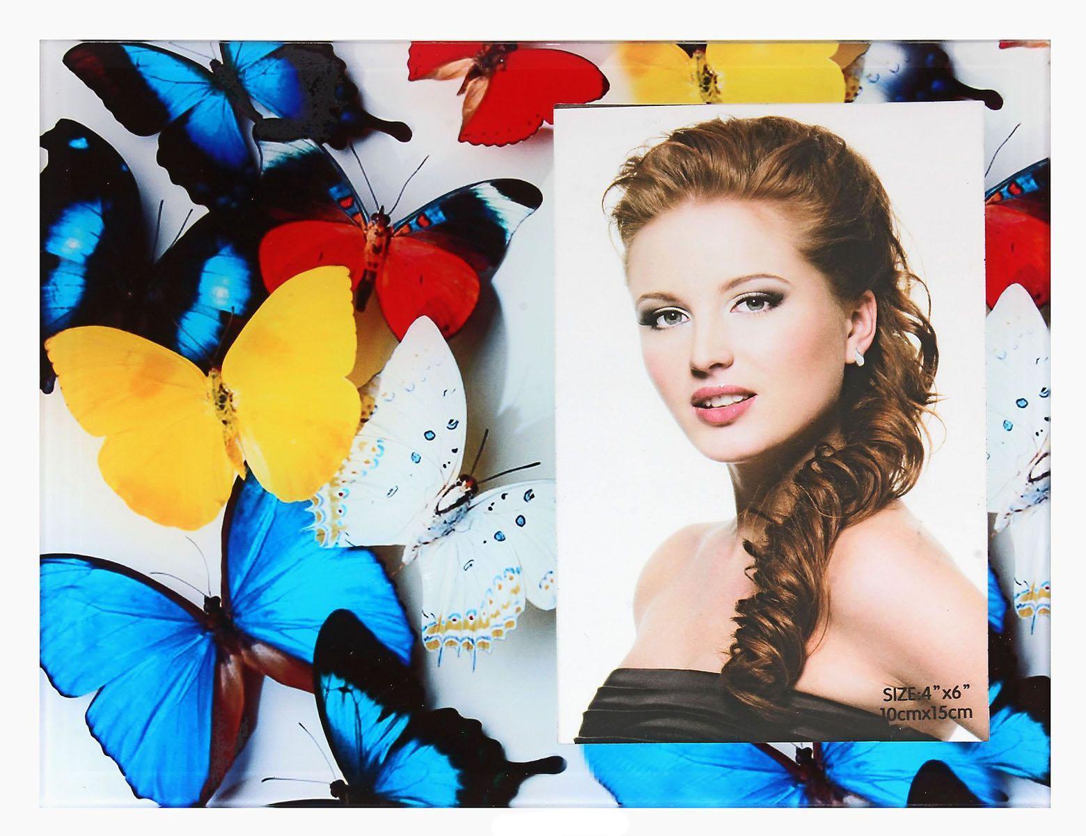 Фоторамка Sima-land Бабочки и я, 10 х 15 см614683Декоративная фоторамка Sima-land Бабочки и я выполнена из стекла и декорирована изображением разноцветных бабочек. Обратная сторона рамки оснащена специальной ножкой, благодаря которой ее можно поставить на стол или любое другое место в доме или офисе. Такая фоторамка украсит ваш интерьер оригинальным образом, а также позволит сохранить память о дорогих вам людях и интересных событиях вашей жизни. С ней вы сможете не просто внести в интерьер своего дома элемент оригинальности, но и создать атмосферу загадочности и изысканности.