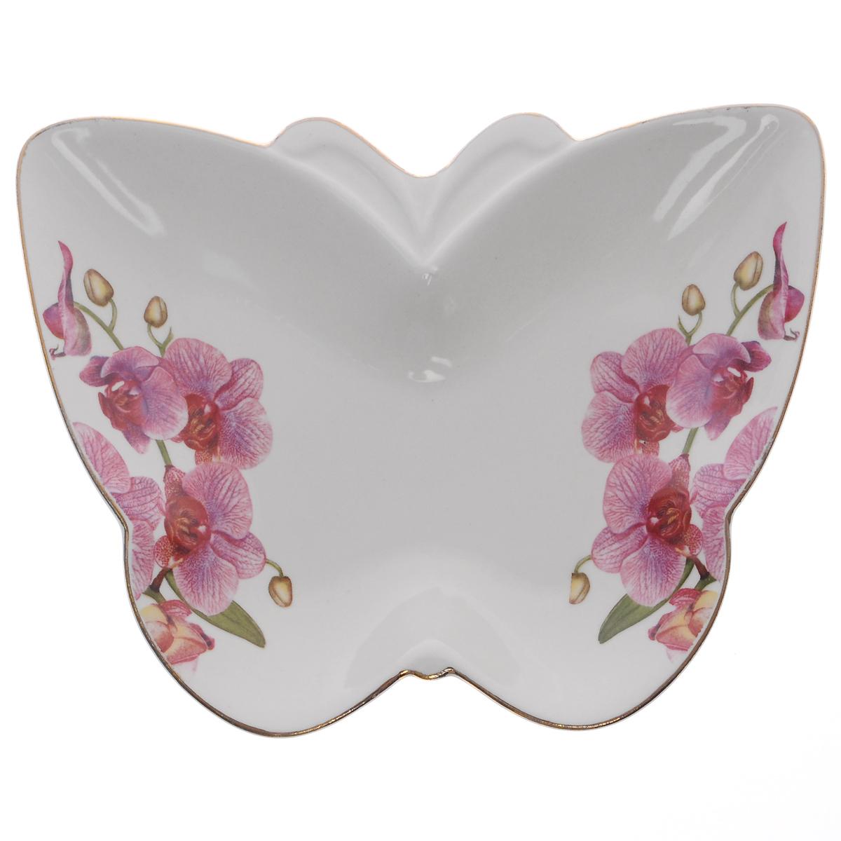 Блюдо Briswild Цветы орхидеи, 18 х 14 см589-100Блюдо Briswild Цветы орхидеи, изготовленное из высококачественного фарфора в виде бабочки, декорировано изображение цветов орхидеи и золотистой окантовкой. Такое блюдо сочетает в себе изысканный дизайн с максимальной функциональностью. Красочность оформления придется по вкусу и ценителям классики, и тем, кто предпочитает утонченность и изысканность.Оригинальное блюдо украсит сервировку вашего стола и подчеркнет прекрасный вкус хозяйки, а также станет отличным подарком.Нельзя использовать в микроволновой печи и мыть в посудомоечной машине.Размер блюда (по верхнему краю): 18 см х 14 см.Высота стенки блюда: 2 см.