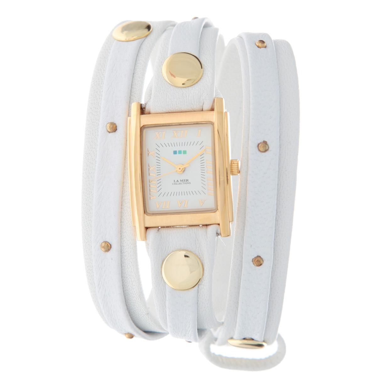 Часы наручные женские La Mer Collections Stud White Gold. LMSW1016GoldLMSW1016GoldЖенские наручные часы  La Mer Collections позволят вам выделиться из толпы и подчеркнуть свою индивидуальность. Часы оснащены японским кварцевым механизмом Seiko. Ремешок двухслойный, выполнен из натуральной итальянской кожи и декорирован металлическими заклепками разных размеров. Корпус часов изготовлен из сплава металлов, золотистого цвета. Циферблат оснащен часовой, минутной и секундной стрелками и защищен минеральным стеклом, оформлен римскими цифрами и отметками.Часы застегиваются на классическую застежку. Часы хранятся на специальной подушечке в футляре из искусственной кожи, крышка которого оформлена логотипом компании La Mer Collection. Характеристики: Размер циферблата: 25 х 22 х 8 мм. Размер ремешка: 550 х 13 мм. Не содержат никель. Ширина верхнего слоя ремешка: 6 мм. Не водостойкие. Собираются вручную в США.