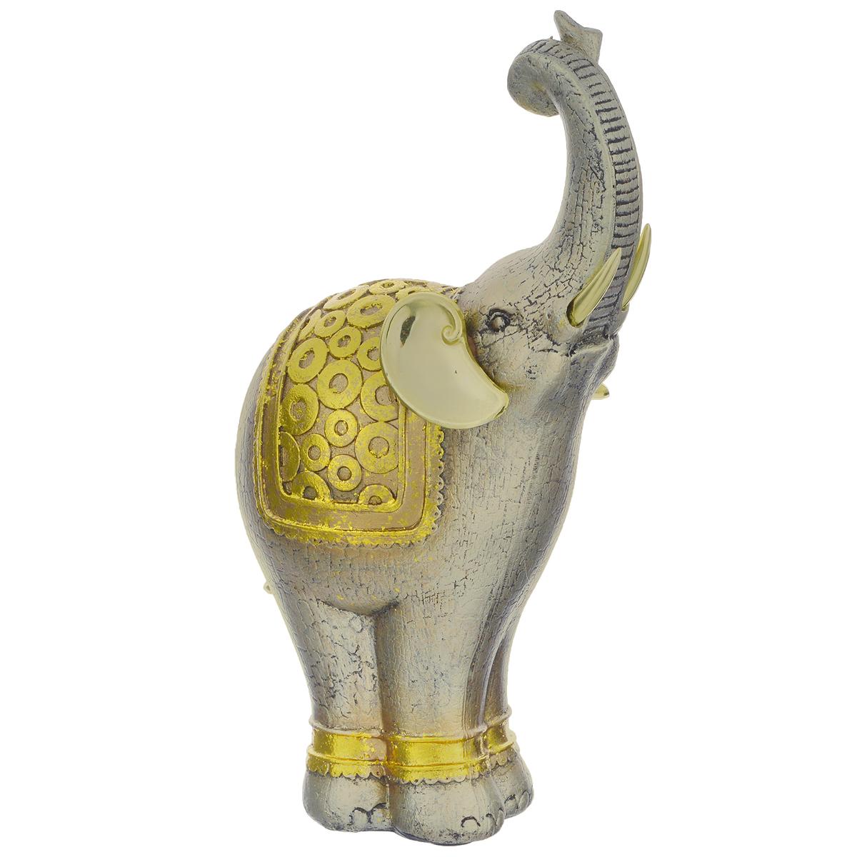Фигурка декоративная Molento Золотой слон, высота 26 см549-036Декоративная фигура Molento Золотой слон, изготовленная из полистоуна, позволит вам украсить интерьер дома, рабочего кабинета или любого другого помещения оригинальным образом. Изделие, выполненное в виде слона, оформлено рельефным рисунком и золотистым напылением.С такой декоративной фигурой вы сможете не просто внести в интерьер элемент оригинальности, но и создать атмосферу загадочности и изысканности.Размер фигурки: 15 см х 9 см х 26 см.