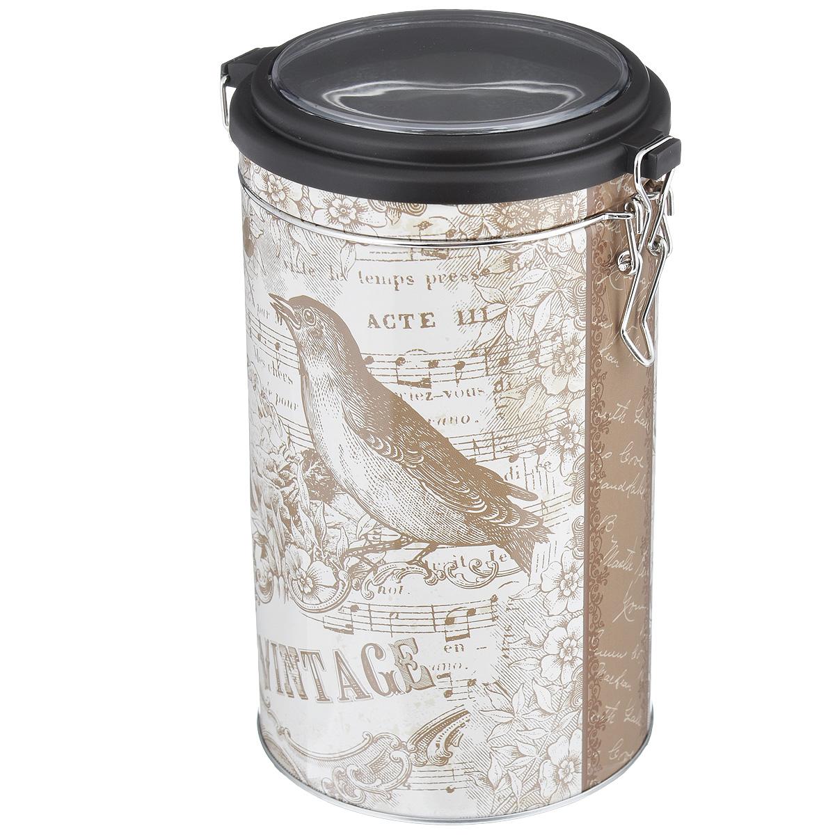 Банка для сыпучих продуктов Феникс-презент Птица, 1,5 л37633Банка для сыпучих продуктов Феникс-презент Птица, изготовленная из окрашенного черного металла, оформлена ярким рисунком. Банка прекрасно подойдет для хранения различных сыпучих продуктов: специй, чая, кофе, сахара, круп и многого другого. Емкость плотно закрывается прозрачной пластиковой крышкой на металлический замок. Благодаря этому она будет дольше сохранять свежесть ваших продуктов.Функциональная и вместительная, такая банка станет незаменимым аксессуаром на любой кухне. Нельзя мыть в посудомоечной машине.Объем банки: 1,5 л.Высота банки (без учета крышки): 17,4 см. Диаметр банки (по верхнему краю): 10,5 см.
