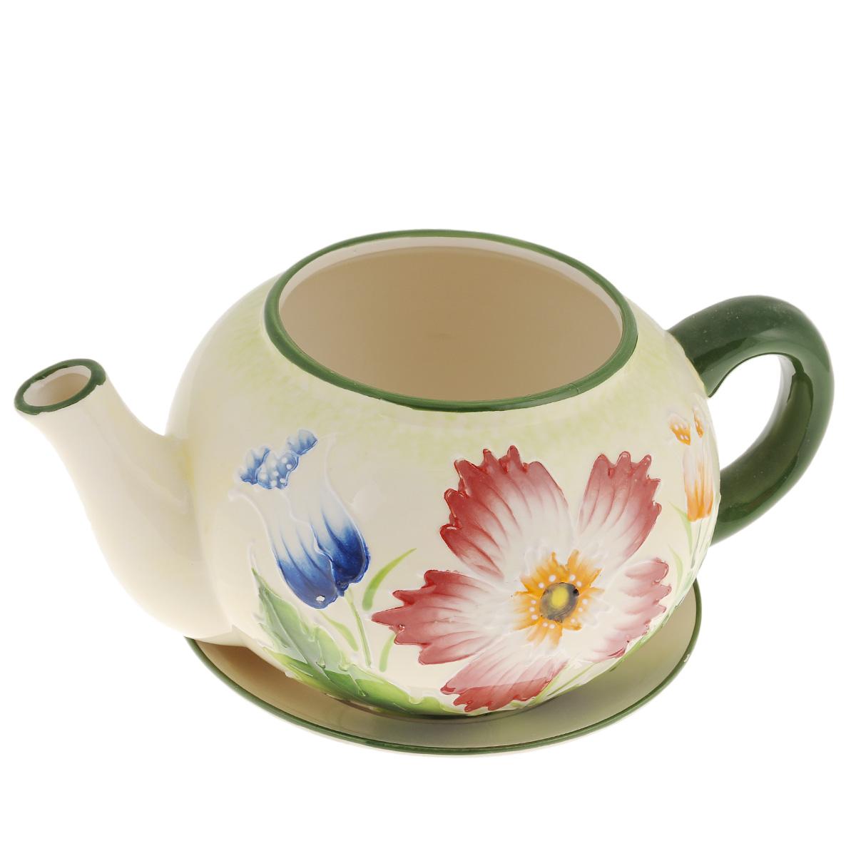 Кашпо Lillo Заварочный чайник, с поддоном. XY10S015-1FXY10S015-1FКашпо-горшок для цветов Lillo Заварочный чайник выполнен из прочной керамики и декорирован красочным рисунком. Изделие предназначено для цветов.Такие изделия часто становятся последним штрихом, который совершенно изменяет интерьер помещения или ландшафтный дизайн сада. Благодаря такому кашпо вы сможете украсить вашу комнату, офис, сад и другие места. Изделие оснащено специальным поддоном - блюдцем.Диаметр кашпо по верхнему краю: 12 см.Высота кашпо (без учета поддона): 14 см.Диаметр поддона: 20,5 см.