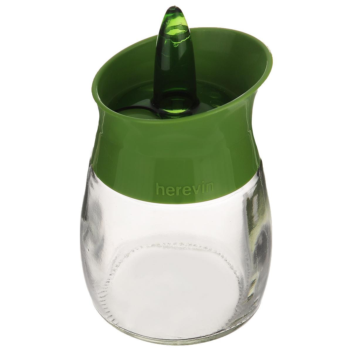 Банка для специй Herevin, цвет: прозрачный, зеленый, 200 мл. 131260-000131260-000_зеленыйБанка для специй Herevin выполнена из прозрачного стекла и оснащена пластиковой цветной крышкой с отверстиями разного размера, благодаря которым, вы сможете приправить блюда, просто перевернув банку. Крышка снабжена поворотным механизмом, благодаря которому вы сможете регулировать степень подачи специй. Крышка легко откручивается, благодаря чему засыпать приправу внутрь очень просто. Такая баночка станет достойным дополнением к вашему кухонному инвентарю. Можно мыть в посудомоечной машине.Диаметр (по верхнему краю): 5,5 см.Высота банки (без учета крышки): 7,5 см.